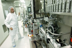 An Israeli system engineer watch over a production line of pharmaceutical medicaments at the Teva factory in Jerusalem on July 05. 2007. Teva Pharmaceutical Industries Ltd. is a global pharmaceutical company specializing in the development, production and marketing of generic and proprietary branded pharmaceuticals and active pharmaceutical ingredients. Teva is among the top 20 pharmaceutical companies and among the largest generic pharmaceutical companies in the world. Teva is among the most traded shares on the Tel Aviv Stock Exchange and among the most widely held Israeli shares on NASDAQ. It is also traded on Seaq International in London and the Frankfurt Stock Exchange.Photo by Olivier Fitoussi /Flash90 *** Local Caption *** îôòìé èáò îäðãñ îôòì øôåàä úøåôåú